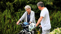 Mature couple with two bikes Footage