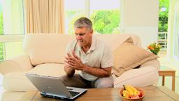 Man losing something on his laptop Footage