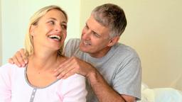 Man massaging his wifes shoulder Live Action