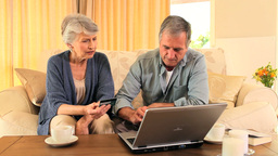 Elderly couple trying to buy something on internet Footage