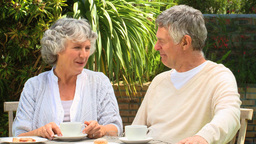 Mature couple having coffee in garden Footage