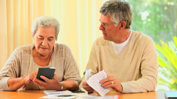 Mature couple sorting out their accounts Footage