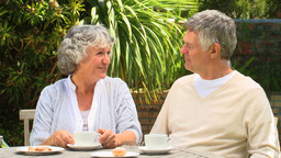Mature couple having coffee in the garden Footage