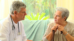 Mature woman patient talking with her doctor Footage