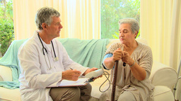 Doctor taking blood pressure Footage
