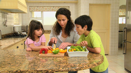 Children helping their mother in the kitchen Live Action