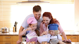 Family standing while cooking together Footage