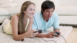 Woman winning in a video game against her boyfriend Live Action