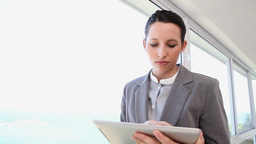 A businesswoman using a tablet Footage