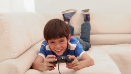 Boy playing videos games Footage