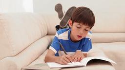 Boy doing his homework Footage