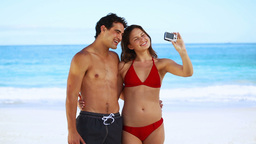 Young couple photographing themselves Footage