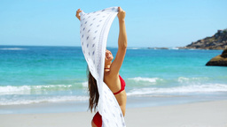 Beautiful woman holding a sarong Footage