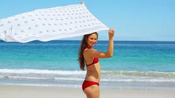 Brunette raising a sarong Live Action