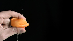 Orange being squeezed in super slow motion Footage