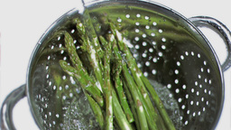 Asparagus being washed in super slow motion Footage