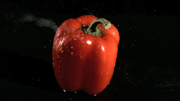 Water sprayed on pepper in super slow motion Footage