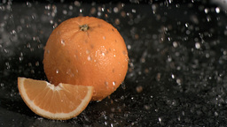 Water raining on oranges in super slow motion Footage