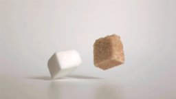 Sugar cubes falling down in super slow motion Live Action