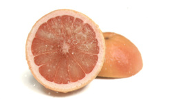 Water sprayed on grapefruit in super slow motion Live Action