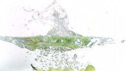 Grapes falling into water in super slow motion Footage
