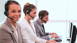 Smiling call centre agents working Footage