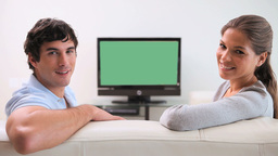 Couple sitting together in front of the television Footage