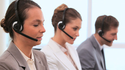 Call centre agents talking with headsets Footage