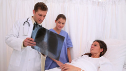 Doctors explaining an xray to a patient Footage