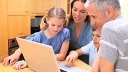 Family standing while looking at a laptop Footage