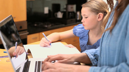 Little girl drawing on her notebook Footage