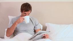 Man reading a magazine Live Action