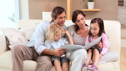 Joyful family reading a book Footage