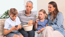 Smiling family watching a movie Footage