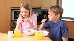 Cute siblings eating their breakfast Footage