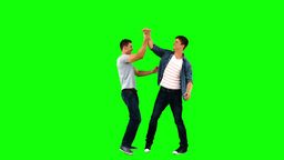Men giving highfive in slow motion Footage