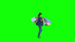 Teenage girl in slow motion holding shopping bags Footage