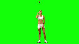 Brunette woman in slow motion throwing an apple Footage