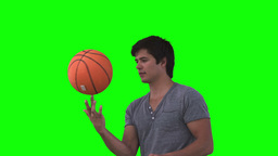 Man playing with a basketball in slow motion Footage
