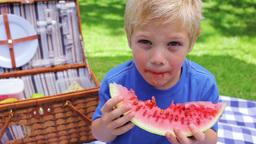 Boy eating a watermelon and smiling Footage