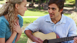 Boyfriend plays the guitar for his girlfriend Footage