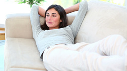 A woman lying on the couch and smiling Footage