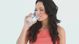 Attractive young woman drinks water Footage