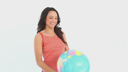 Girls plays with a globe Footage