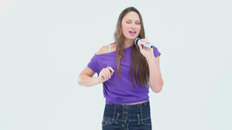 Girl singing karaoke Footage
