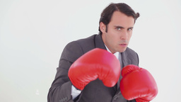 Serious man using boxing gloves Footage