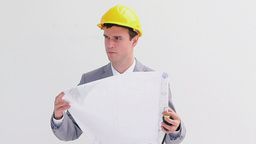 Serious worker reading blueprints Footage