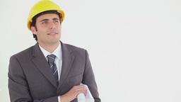 Smiling businessman reading blueprints Footage