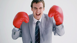 Smiling businessman wearing boxing gloves Footage