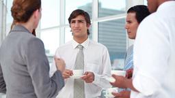Colleagues talking at coffee break Footage